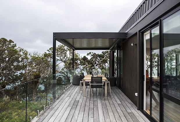 Exterior deck of Langs Beach holiday home Auckland