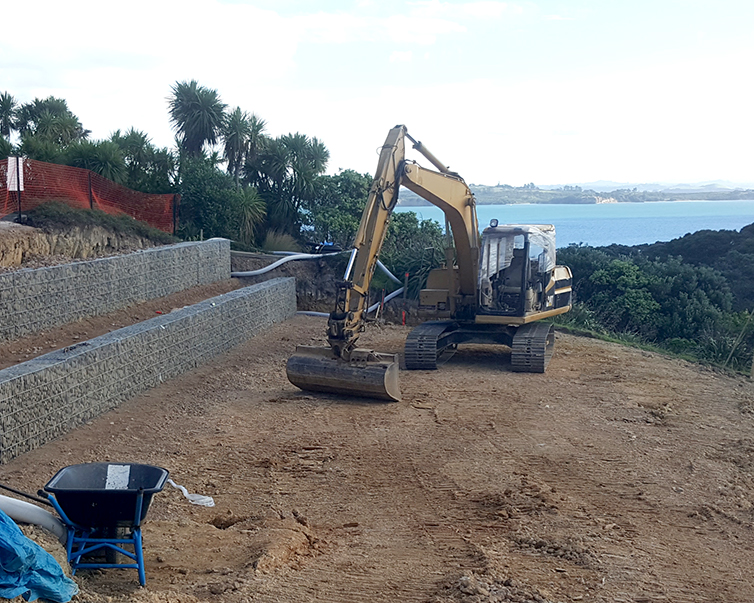 Home Building Budgets | Digger on Waiheke Island House Construction Site
